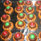Chocolate Pretzel Treats - Have the kids help make these fun chocolate pretzels treats with just three simple ingredients: pretzels, candy kisses, and candy-coated chocolate pieces.