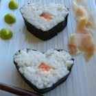 Sarah's Special Sushi - This California-style fusion sushi features untraditional but delicious smoked salmon and cream cheese rolled into nori seaweed sheets with sushi rice, then sliced into rounds.