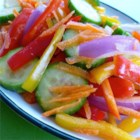 Fresh and Crisp Cucumber Salad - Fresh lemon juice and lemon zest make a simple, fresh dressing for this cucumber salad with carrot and bell pepper.