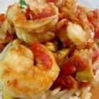 Shrimp Primavera with Sun-Dried Tomatoes - Bright and tangy sun-dried tomatoes turn an everyday pasta dish into memorable meal with succulent shrimp and chunks of artichoke.