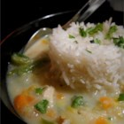 Chicken Rice Soup - Cream cheese gives this comforting chicken and rice soup a rich texture.