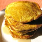 Paleo Pancakes - These pumpkin pancakes are paleo-friendly and seasoned with cloves, ginger, and cinnamon.