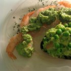 Avocado Prawns - Pan-fried prawns are simmered briefly in a sauce of mashed avocado, lemon juice, and parsley for a brightly delicious dish.
