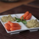 5-Minute Olive Hummus - Olives, basil, and parsley add new flavors to homemade hummus.