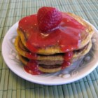 Paleo Pancakes with Pureed Strawberries - This flourless, paleo-friendly pancake recipe is topped with pureed strawberries.