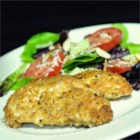 Grain-Free Chicken Tenders - Chicken strips coated in almond flour and Parmesan cheese are baked into crispy, grain-free chicken tenders sure to please the whole family.