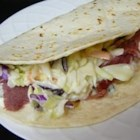 Irish Tacos - Ireland meets Mexico in a fun, easy alternative to a sandwich -- a corned beef and coleslaw taco, served with a gently spicy yogurt-cilantro sauce. It's a good way to use up any corned beef leftovers after the big day.
