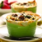 Baked Egg Cups with Country Style Chicken Sausage - Phyllo-dough cups filled with country style chicken sausage, eggs, and spinach and topped with shredded cheese are a delicious way to start your day!