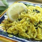 Orzo with Kale - Toothsome kale and golden orzo pasta are dressed with Parmesan cheese and fresh lemon juice in this delicious pasta side dish.