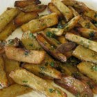 Oven Baked Garlic and Parmesan Fries - Parmesan cheese, parsley, and even more Parmesan cheese coat these delicious oven-baked fries.