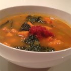 Paleo Chorizo Sweet Potato and Kale Stew - This nutritious soup of chorizo, kale, and sweet potatoes takes inspiration from the flavors of Spain. Garnish with store-bought (or homemade) harissa to add heat.