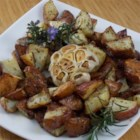 Rosemary Potatoes with Roasted Heads of Garlic - Rosemary potatoes make a pretty terrific side dish, but when you add roasted garlic, you get a crowd-pleasing favorite.