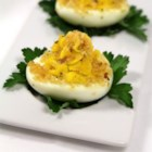 Great Easter Appetizer - Hard cooked eggs are topped with a ham and cream cheese mixture and seasoned bread crumbs, then baked.