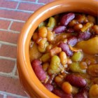 4-Bean Baked Beans - Four different varieties of beans are baked with bacon, molasses, and brown sugar for a sweet and savory picnic side dish.