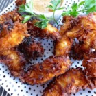 Beer Batter Coconut Shrimp - Peeled shrimp are dipped in a simple beer batter and coated with sweetened coconut flakes for a quick appetizer or dinner.