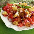 Italian Bread Salad with Strawberries and Tomatoes - Diced strawberries add an unexpected sweetness to this toasted Italian bread salad. Perfect for a summer day.