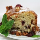 Cranberry-Pecan Olive Oil Cake - Swap olive oil for butter in this  soft, cranberry-pecan cake. It is a perfect cake to bring to parties or picnics.