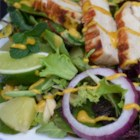 Tandoori Chicken Salad - Tangy grilled chicken atop a bed of greens mixed with onions, raisins, almonds, pineapple, mint sprigs, and lime.  Includes a zesty Indian-style salad dressing.