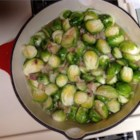Brussels Sprouts ala Angela - Brussels sprouts are steamed in stock with pan-fried bacon, onion, and garlic in this tasty side dish.