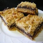 Calypso Bars - Chocolate and dates are sandwiched between a buttery oat layer creating a rich dessert for any occasion.