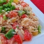 Crab and Orzo Salad - A spicy dressing mixes perfectly with cool crab meat, tomatoes, and peppers.