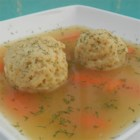 Matzoh Ball Soup - Otherwise known as New York penicillin, this soup is good for colds, flu, and heartaches.  Matzoh balls are made from matzoh meal, eggs, and oil or chicken fat, and added to a chicken and vegetable soup.