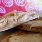Peanut Butter Banana Quesadilla - Give your quesadillas a sweet twist by filling them with peanut butter and banana for a perfect start to the day.