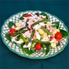 Asparagus and Crab Salad - A mixture of imitation crabmeat, asparagus, tomatoes, and hearts of palm are dressed with a simple lemon dressing in this salad recipe.