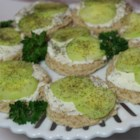 Summer Time Cucumber Sandwiches - Small slices of cocktail rye bread are spread with ranch-flavored cream cheese and topped with a cucumber slice and a sprinkling of dill for a savory little appetizer canape.