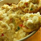 Hot Artichoke and Crab Dip - A hot baked dip meant to be served with slices of French baguette has the rich flavors of artichoke hearts and crab meat.