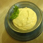 Basil and Sun-Dried Tomato Dip - Sour cream and mayonnaise make a base for a dip spiked with sun-dried tomatoes, basil, and lemon juice.