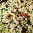 Kate's Kale Couscous  - Whole wheat couscous, kale, cannellini beans, and almonds make a hearty vegetarian meal even meat-eaters will enjoy.