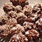 Date Haroset - Dates and raisins are simmered in a touch of wine, rolled with cinnamon and nuts into bite-sized balls, and dusted with confectioners' sugar to make a scrumptious treat for your holiday gathering.
