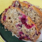 Honey Cranberry Oat Bread - This sweet, smooth honey-oat quick bread gets its pizzazz from crunchy nuts and tart cranberries.
