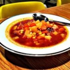 Different Ham and Potato Soup  - A slow cooker soup starts its life with a ham bone and cubed potatoes, but tomato paste, carrots, Creole and Italian seasonings take it someplace different.