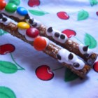 Picnic Sticks - Pretzel rods coated with three chocolate chips in a row to look like 'ants' are a fun treat to make with favorite kid cooks.