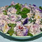 Warm Fingerling Potato Salad - A simple but zesty potato salad is made with a light, lemony yogurt dressing, tender little fingerling potatoes, and arugula leaves. Serve warm.