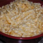 Tasty Baked Mac n Cheese - A rich macaroni and cheese casserole made with sour cream, butter, and two kinds of Cheddar cheese is ready in less than an hour but is fancy enough for a holiday dinner.