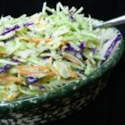 Brookville Hotel Sweet and Sour Coleslaw - An easy, 5-ingredient recipe for coleslaw from a famous Kansas restaurant doesn't need mayonnaise. Make the slaw ahead of time and let it chill for several hours before serving. It's great for a potluck.