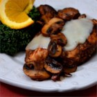 Poulet de Provencal - Chicken breast halves are cooked with balsamic vinegar and browned mushrooms, then served topped with melted provolone cheese for a quick French-inspired main dish.