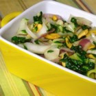 Stir Fried Bok Choy - Bok choy is stir-fried with cashews, Chinese five-spice, and garlic for a quick and easy Asian-inspired side dish.