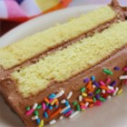One - Two - Three - Four Cake II - Butter, flour, sugar, and eggs are the main ingredients in this classic yellow layer cake.