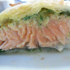 Puff Pastry Salmon - An excellent blend of salmon, pesto, spinach, and puff pastry.  It tastes great and only takes a few minutes to put it all together!