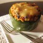 Vegetarian Mexican Inspired Stuffed Peppers - Green bell peppers are stuffed with rice, chili-style tomatoes, and Mexican cheese blend, creating a hearty and not-too-spicy vegetarian dinner the whole family will love.
