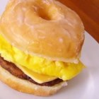 Breakfast Sandwich Heaven - Sausage, egg, and cheese are sandwiched into glazed donut to make a quick and unique breakfast sandwich.