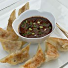 Dumpling Dipping Sauce - This dipping sauce with two kinds of soy sauce, chili oil, garlic, and ginger is great for dipping Asian-style finger foods like egg rolls and pot stickers.