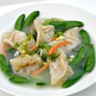 Pork Wonton Soup - Steamed pork-filled wontons and steamed vegetables make a hearty and satisfying soup.