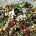 Mediterranean Quinoa Salad - Chicken breast cubes, feta cheese, and kalamata olives combine with quinoa in this salad that is equally good warm or cold.