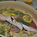 Red Snapper with Fennel and Garlic - A whole red snapper is stuffed with a shallot and fennel stuffing, drizzled with white wine and lemon juice, then tied and baked in the oven until flaky in this dish.