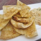 Perfect Pita Chips - You can quickly make your own pita chips with just a package of pita pockets, olive oil, garlic powder, garlic salt, and this recipe.